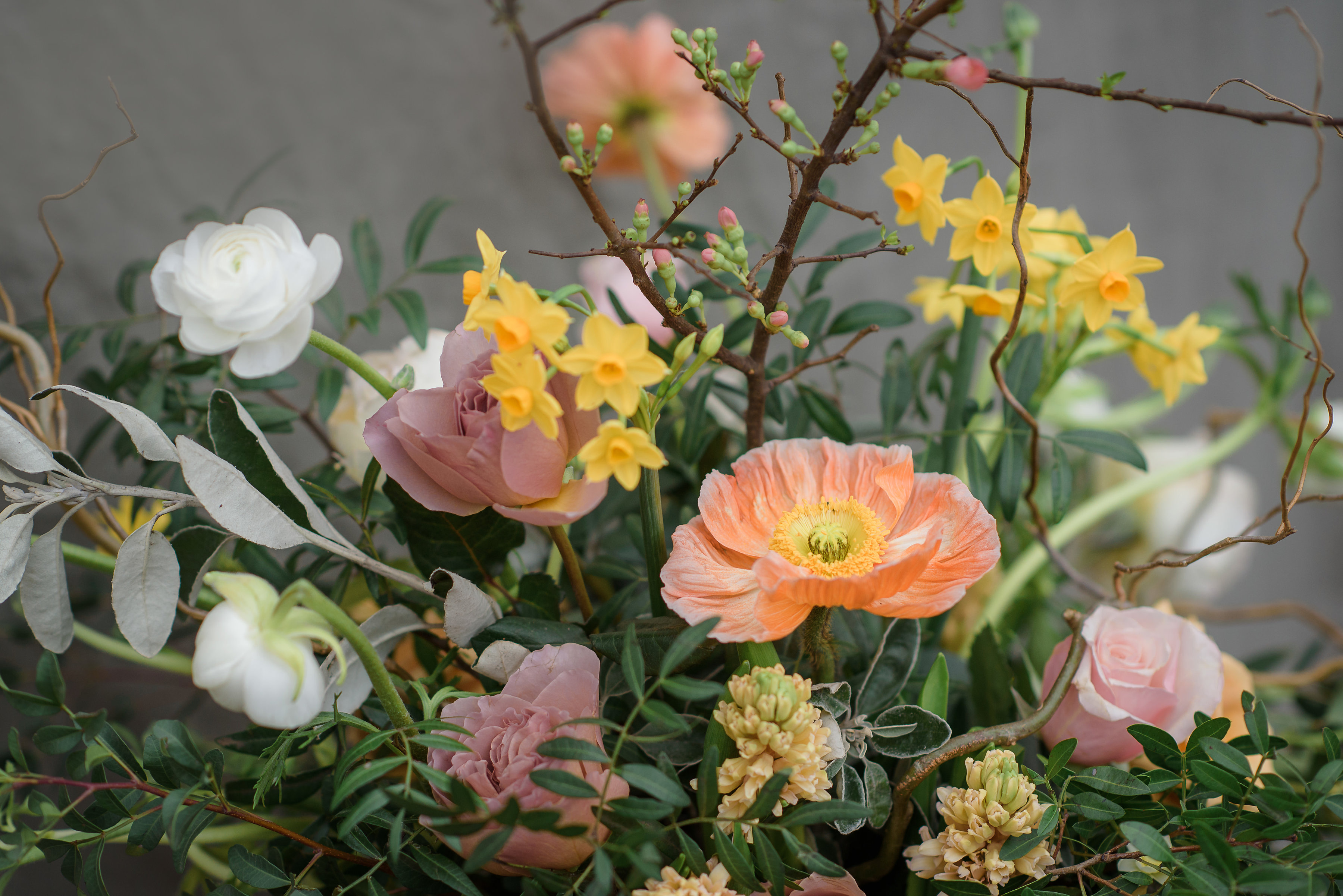 Peach and yellow lovely floral arrangement by Jane Farthing